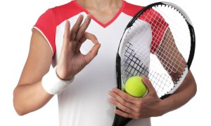 female tennis player making the sign all is well